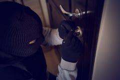 Burglar breaking into the lock royalty free stock photos