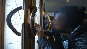 A burglar breaking the lock stock video footage