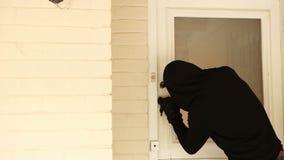 Burglar breaking open the door stock footage