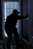 Burglar Breaking In To Home At Night Through Back Royalty Free Stock Photos