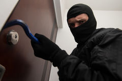 Burglar Breaks Into A Residential Building Stock Image