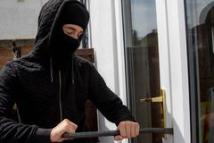 Burglar. Breaking into ready to enter a property stock photography