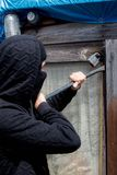 Burglar. Breaking into ready to enter a property royalty free stock images
