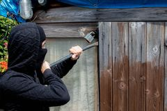 Burglar. Breaking into ready to enter a property royalty free stock photography