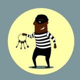 Burglar carrying a set of keys Royalty Free Stock Image