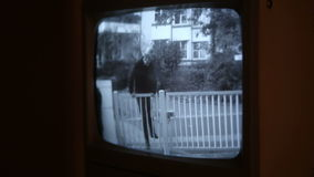 Burglar caught on camera trying to climb over fence stock footage
