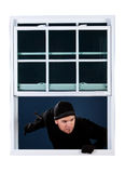 Burglar: Coming in an Open Window Stock Image