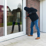 Burglar with a crowbar stock image