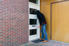 Burglar with a crowbar Royalty Free Stock Photo