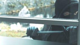 Burglar with crowbar break door to enter the house stock video