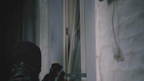 Burglar with crowbar break door to enter the house stock footage