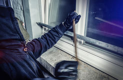 Burglar with crowbar break door to enter the house Royalty Free Stock Image