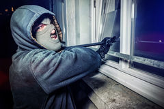Burglar with crowbar break door to enter the house Royalty Free Stock Photos