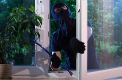 Burglar with crowbar Stock Photography