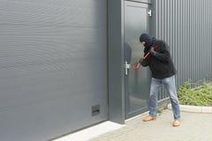Burglar with a crowbar Stock Photos