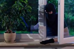 Burglar with a crowbar Stock Images