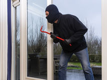 Burglar with a crowbar Royalty Free Stock Images