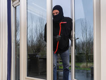 Burglar with a crowbar Stock Images