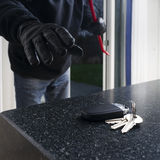 Burglar with a crowbar Royalty Free Stock Photography