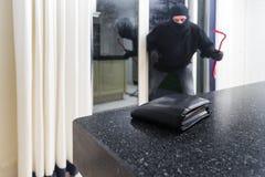 Burglar with a crowbar Stock Image