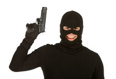 Burglar: Evil Burglar with Gun. Series with Caucasian male as a burglar or thief, sneaking in a window, carrying stolen goods, etc.  Isolated on white background Stock Photo