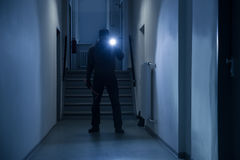 Burglar With Flashlight And Crowbar In Office Corridor Stock Images