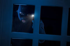 Burglar with flashlight Royalty Free Stock Images