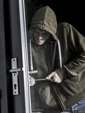 Burglar forcing door Stock Photography
