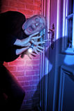 Burglar getting caught by door. Burglar getting caught red handed breaking into a home stock image