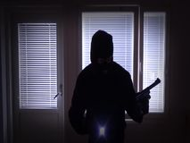 Burglar with gun breaking in from window stock footage