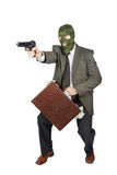 Burglar with the gun and a suitcase full of money. Isolated over white background royalty free stock image