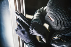 Burglar with Gun and torch Royalty Free Stock Images