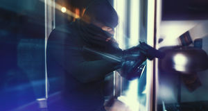 Burglar with Gun and torch stock photos