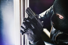Burglar with Gun and torch Royalty Free Stock Photos