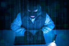 Burglar hacker stealing data in dark Stock Photo