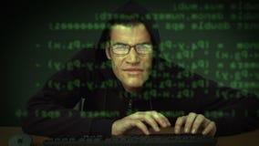 Burglar hacking into computer stock footage