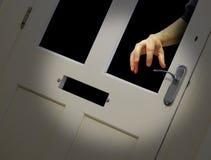 Burglar hand through broken glass door Stock Images
