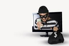Burglar. Happy Burglar stealing money in a computer monitor on a white background royalty free stock images