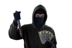 Burglar hold bloody knife and dollar. Male burglar wearing mask and hoodie while holding a bloody knife and money cash, isolated on white royalty free stock photo