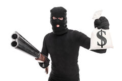 Burglar holding a bag of money and a shotgun Stock Photography