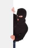 Burglar Holding Blank Placard Royalty Free Stock Photography
