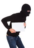 Burglar Holding Blank Placard. Burglar Man Holding Blank Placard And Looking Back Over White Background Royalty Free Stock Image
