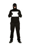 Burglar: Holding a Blank Sign. Series with Caucasian male as a burglar or thief, sneaking in a window, carrying stolen goods, etc.  Isolated on white background Stock Photography