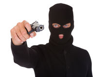 Burglar Holding Hand Gun. Portrait Of A Burglar With Balaclava Holding Hand Gun Isolated On White Background royalty free stock images