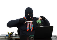 Burglar holding a knife and hard disk speaking on Skype Royalty Free Stock Photography