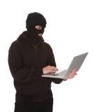 Burglar Holding Laptop Stock Image