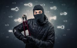 Burglar holding tool. Burglar standing with tools in his hand Stock Images