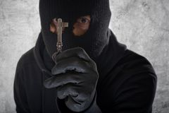 Burglar with a key Royalty Free Stock Photo