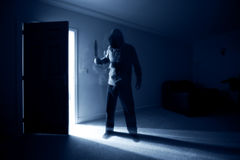 Burglar with knife Royalty Free Stock Image