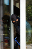 Burglar leaning out Stock Photos